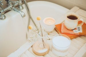 Spa day at home - bathtub with tea and candles