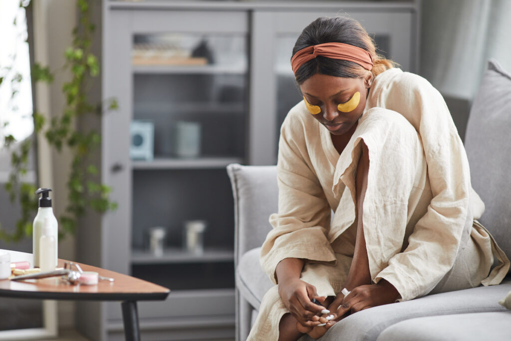 Woman pampering herself waiting for her Changes self-care day
